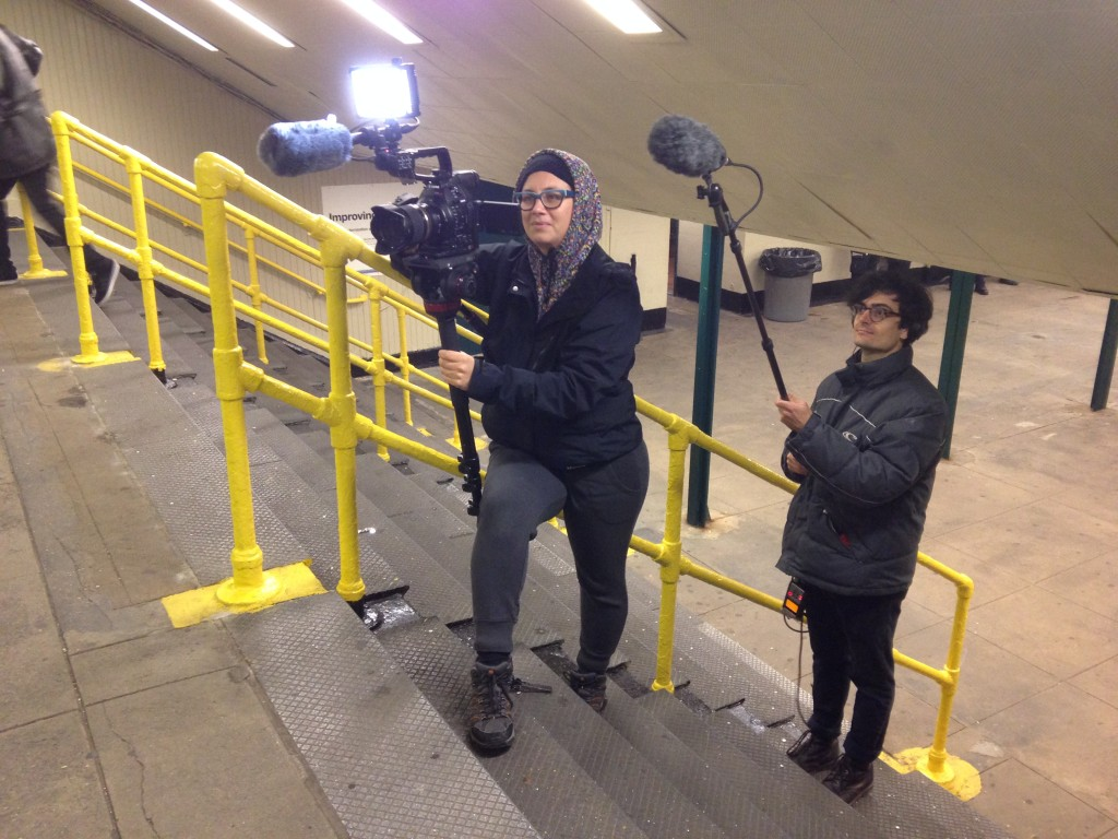 Martyna and Raphael, at the 7 Train Willets Point station, capturing all of the pent-up fan excitement.